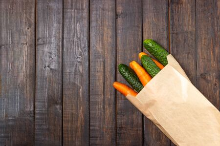 Paper bag with food stock vegetables. Food delivery and donation service. Copy space.