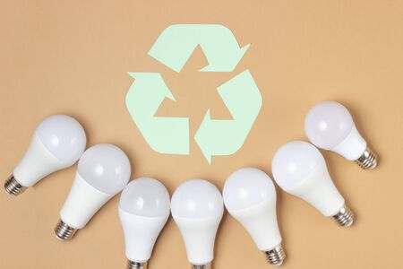 Energy saving light bulbs on a light background. Ecology care concept. Standard-Bild