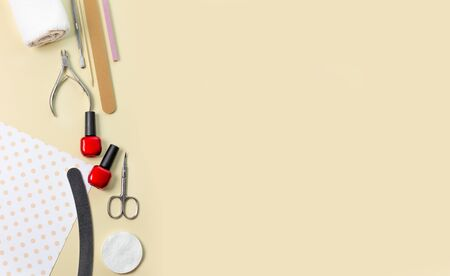 Tools for manicure . Nail files, scissors and nail polishes top view. Nail Salon, Beauty Salon