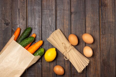 Food stock. Vegetables, eggs and pasta. Food delivery and donation service. Copy space.