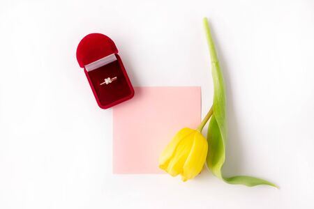 Yellow tulip on a white background with a card for adding notes and congratulations