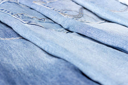 Denim texture. Texture of ripped light blue jeans