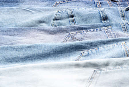 Denim texture. Texture of ripped light blue jeans Standard-Bild
