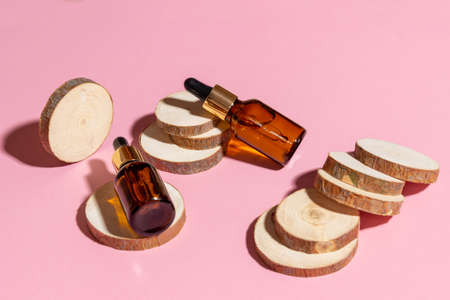 Natural cosmetics in glass bottles with a dropper on a beige background. The concept of natural cosmetics, natural essential oil.