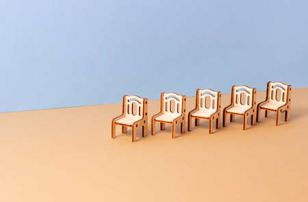 A toy miniature wooden bedroom furniture stands. Furniture for dolls and dollhouse