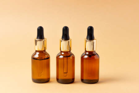 A set of amber bottles for essential oils and cosmetics. Glass bottle. Dropper, spray bottle 写真素材