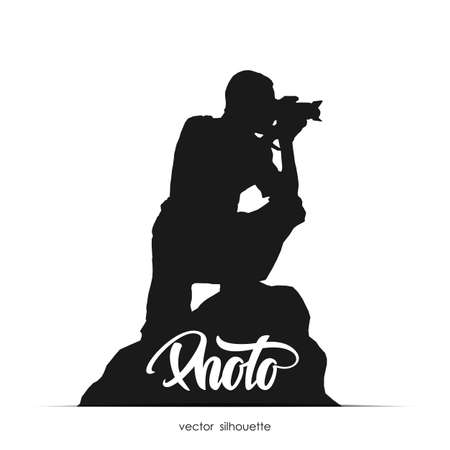 Silhouette of photographer sitting on stone isolated on white background.