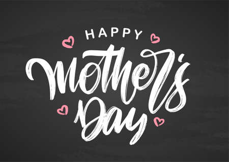 Handwritten brush lettering composition of Happy Mothers Day on chalkboard background.