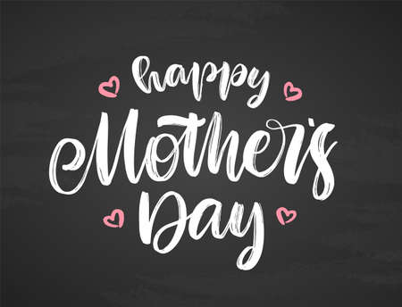 Handwritten brush lettering of Happy Mothers Day on chalkboard background.
