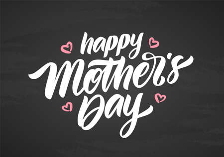 Handwritten calligraphic brush lettering of Happy Mothers Day on chalkboard background.