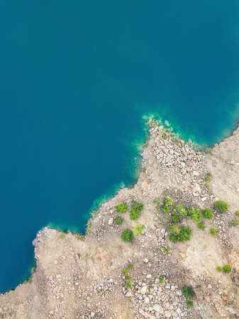 Aerial view on Rocky coast and blue water of lake. Фото со стока - 127762577
