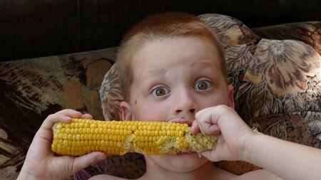 Cute Boy Eating Healthy Corn