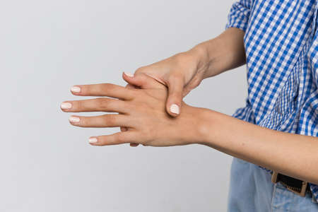 Close-up shot of a woman suffering from weakness and weakness, rheumatoid arthritis, wrist sprain, carpal tunnel syndrome, Healthcare and medicine concept.