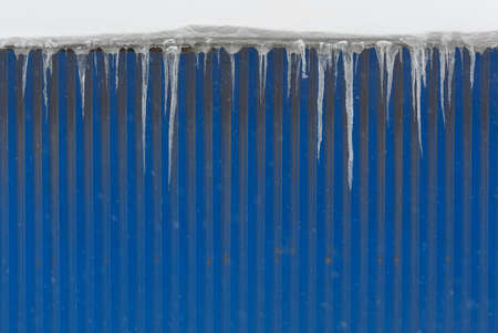Icicles hanging from the blue wall