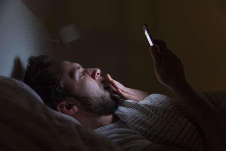 Adult sleepy man awake late at night