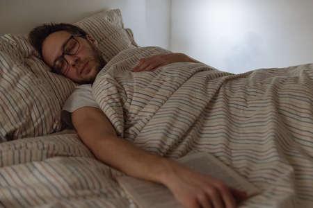 Dressed adult man with a beard fell asleep