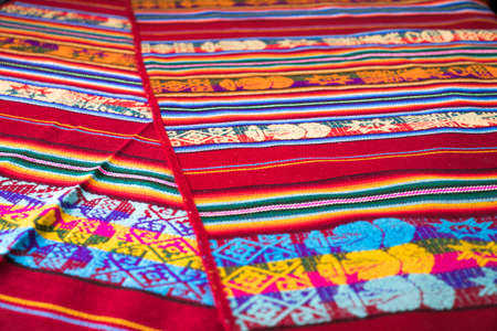 Peruvian traditional woven wool fabric background, colorful Foto de archivo - 102200325