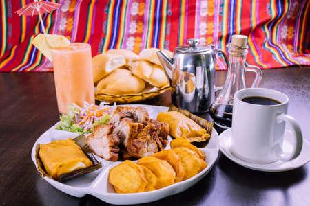 peruvian food: breakfast tamales with chicharron Foto de archivo - 104499071