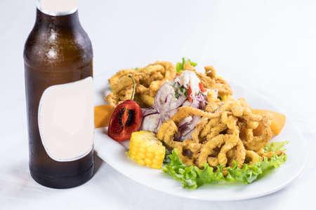 peruvian food: fish ceviche with squid Foto de archivo - 104499077