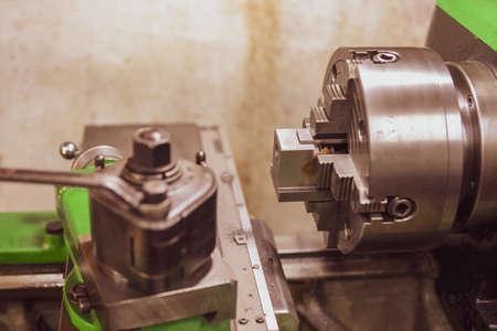 Close-up of lathe manufacturing process of tack work.