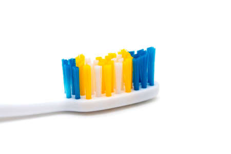 White background on it toothbrushes of different colors are arranged in a chaotic manner oral hygiene isolate, brushing teeth