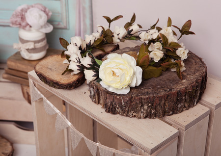 White rose on wooden plate on wooden box.Pink doors,flowers,apple boxes.Great for wedding interior