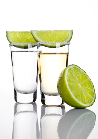 silver bars: Silver tequila shot glass with lime slice and salt on white background
