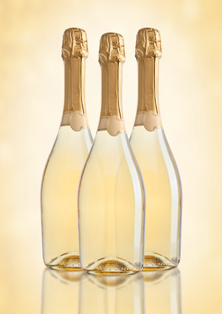 popping cork: Bottles of champagne golden yellow color on golden background