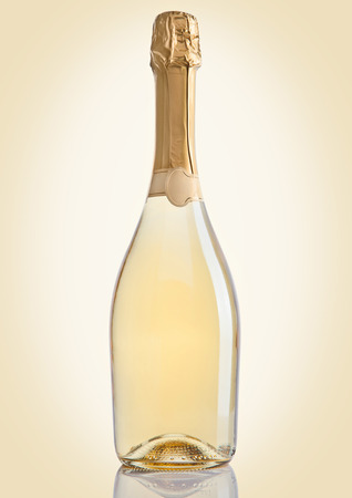 Bottle of champagne golden yellow color on golden background