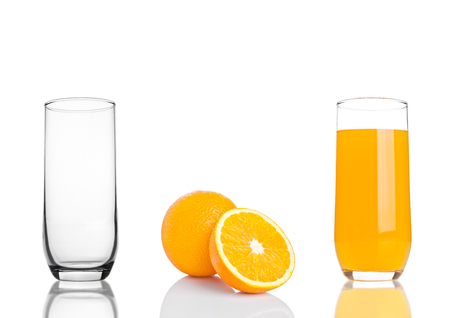 vaso vacio: Glass of healthy organic orange juice on white background with fruit and empty glass