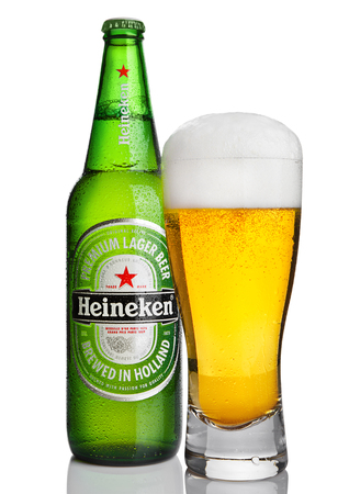 LONDON,UK -OCTOBER 23, 2016: Bottle of Heineken Lager Beer with glass on white background. Heineken is the flagship product of Heineken International Editorial