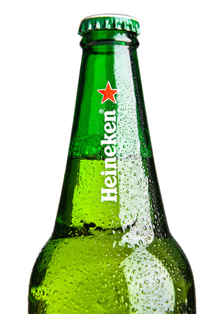 LONDON,UK -OCTOBER 23, 2016: Bottle of Heineken Lager Beer on white background. Heineken is the flagship product of Heineken International
