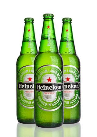 LONDON,UK -OCTOBER 23, 2016: Bottles of Heineken Lager Beer on white background. Heineken is the flagship product of Heineken International