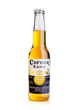 LONDON, UNITED KINGDOM - October 23, 2016: Bottle of Corona Extra Beer on white. Corona, produced by Grupo Modelo with Anheuser Busch InBev, is the most popular imported beer in the US.