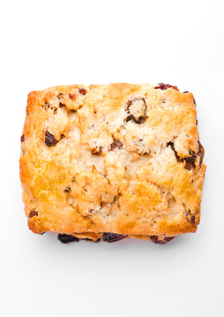 energizing: Fresh fruit scone with raisins on white background