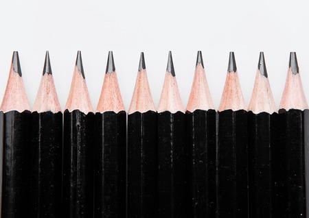 grafit: Black graphite pencils closeup  on white background