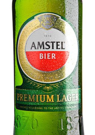 LONDON, UNITED KINGDOM - NOVEMBER 01, 2016: Cold bottle of Amstel Premium Lager on white background.Amstel is an internationally known brand of beer produced by Heineken International in Zoeterwoude, Netherlands.