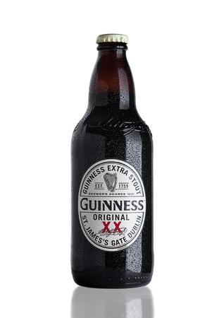 LONDON, UK - NOVEMBER 29, 2016: Guinness extra stout beer  bottle on white background. Guinness beer has been produced since 1759 in Dublin, Ireland.