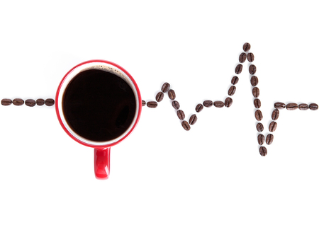 Red cup of coffee with heartbeat beans on white background
