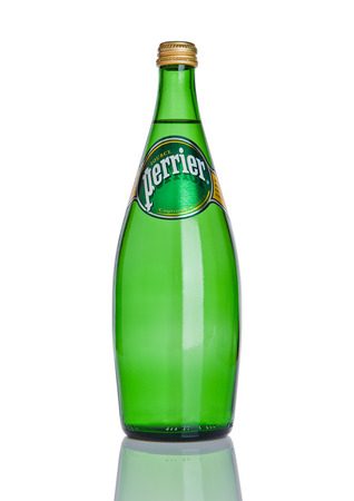 LONDON, UK - DECEMBER 06, 2016: Bottle of Perrier sparkling water. Perrier is a French brand of natural bottled mineral water sold worldwide.