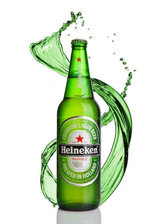 LONDON,UK -JANUARY 02, 2017: Bottle of Heineken Lager Beer  with splash on white background. Heineken is the flagship product of Heineken International Publikacyjne