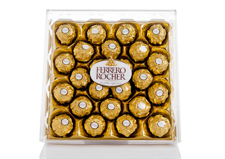 ferrero: LONDON, UK - FEBRUARY 28, Ferrero Rocher premium chocolate sweets plastic box.Produced by the Italian chocolatier Ferrero SpA. Editorial