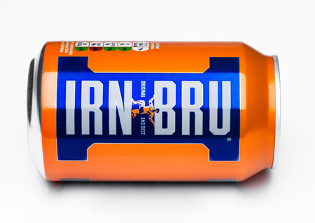LONDON, UK - MARCH 15, 2017: Can of Irn-Bru lemonade soda drink on white background. Produced by Barr in Scotland, UK Редакционное
