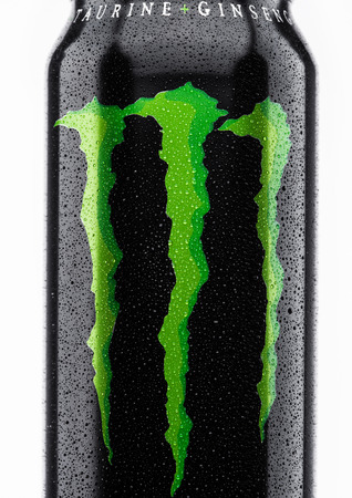 LONDON, UK - MARCH 15, 2017:  A can of Monster Energy Drink on white background. Introduced in 2002 Monster now has over 30 different drinks with high a caffeine content. Editorial