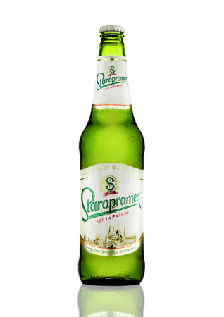 molson: LONDON, UK - MARCH 15, 2017: Bottle of Staropramen premium beer on white background with reflection. Staropramen brewery was founded in Praque in 1869. Editorial
