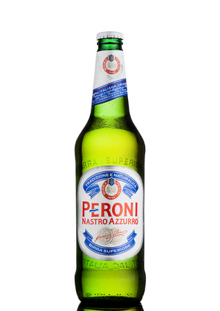 LONDON, UK - MARCH 15, 2017: Cold bottle of Peroni Beer with reflection. Founded n the town of Vigevano, Italy in 1846.