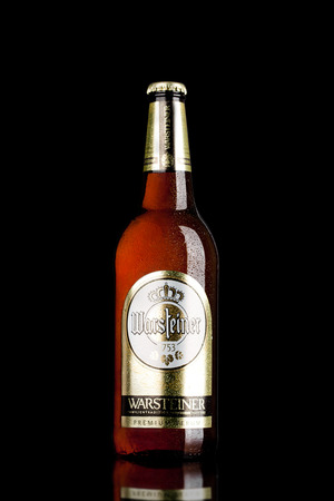 LONDON,UK - MARCH 21, 2017 : Bottle of Warsteiner Beer on black background. Product of Germanys largest privately owned brewery.
