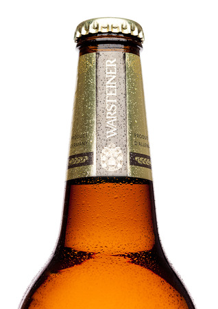 LONDON,UK - MARCH 21, 2017 : Bottle of Warsteiner Beer on white background. Product of Germanys largest privately owned brewery.