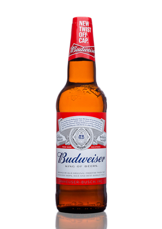 LONDON,UK - MARCH 21, 2017 : Bottle of Budweiser Beer with new twist off cap on white background. An American lager first introduced in 1876. Editorial