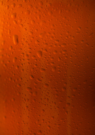 Brown glass beer bottle close up with dew drops texture Stock Photo